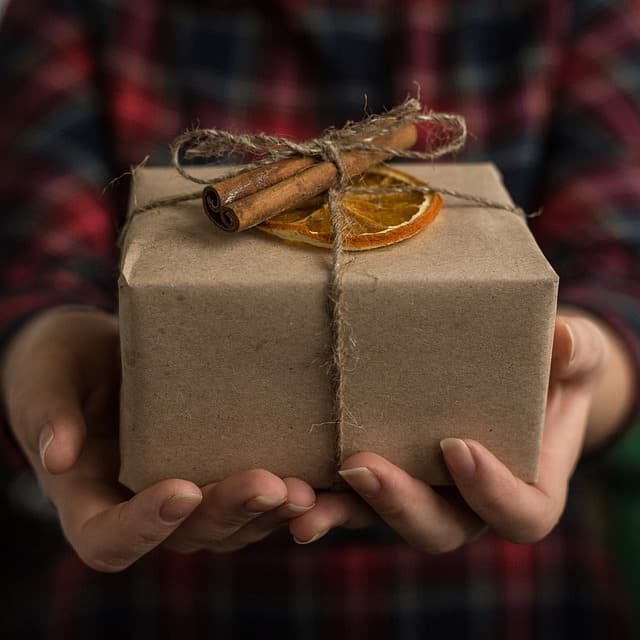 person holding a gift box