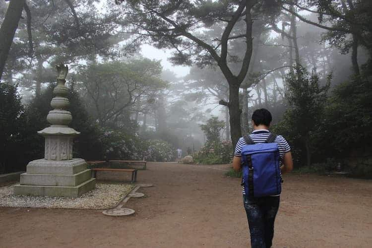 man walking to one of the temples in busan